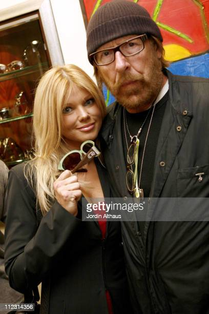 Donna D'Errico and Larry Sands during Grand Opening of Optical Shop of Aspen in Malibu March 15 2007 at Optical Shop of Aspen in Malibu California...