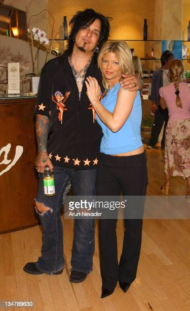 Donna D'Errico with husband Nikki Sixx drinking Vitamin Water by Glaceau