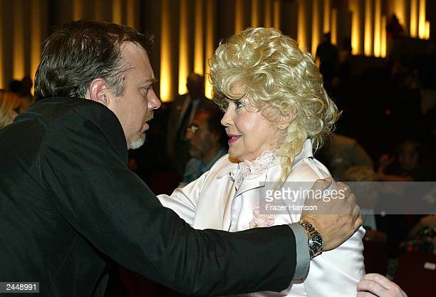 Donna Douglas Ellie May from the Beverly Hillbillies and Dustin Ebsen son of Buddy Ebsen hug at the Academy of Television Arts and Sciences...