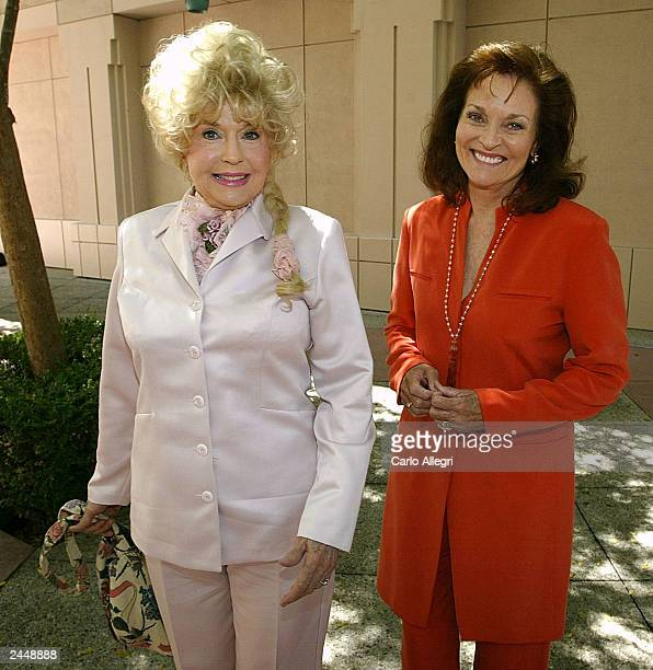 Donna Douglas Ellie May from the show Beverly Hillbillies and Lee Meriwether hug outside the Academy of Television Arts and Sciences Auditorium...