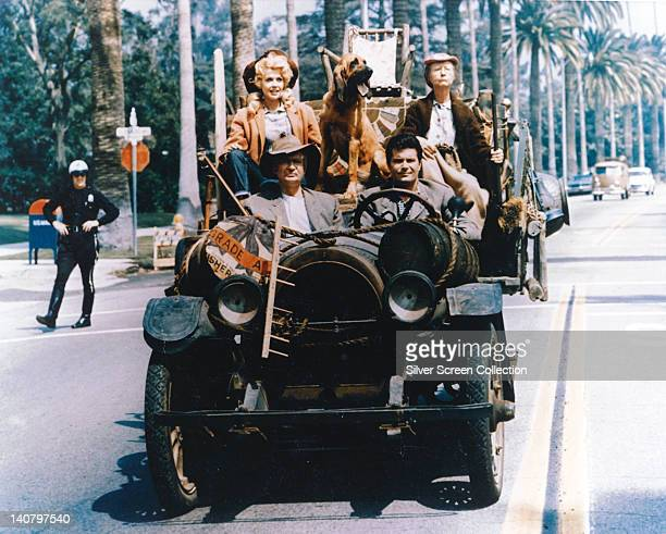 Donna Douglas US actress Irene Ryan US actress Max Baer Jr US actor and Buddy Ebsen driving in the family car in a publicity still issued for the US...