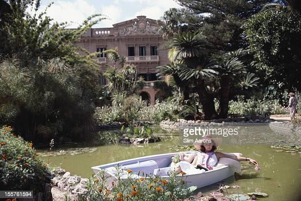 Donna Fabrizia Lanza di Mazzarino relaxing in a boat on a small lake in the grounds of the Villa Tasca d'Almerita in Sicily Italy in October 1984
