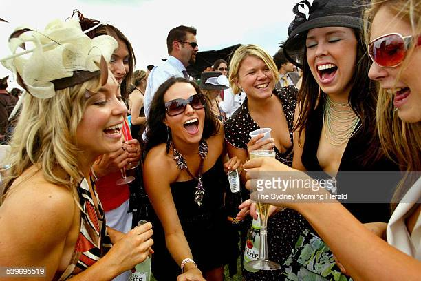 Donna Freak Gabi Adolphe Val Lishnak Alex Adams and April Comer pour out the champagne during the Melbourne Cup race day at Royal Randwick 2 November...