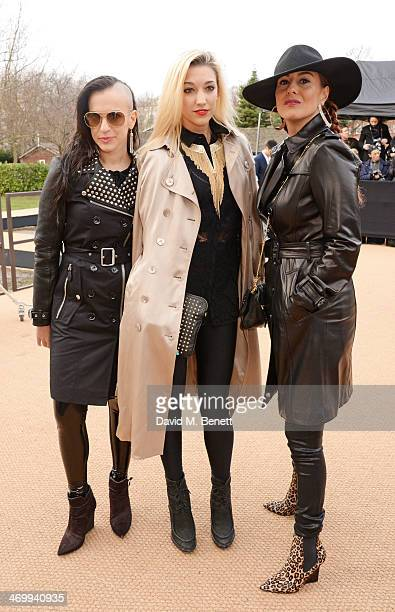 Donna Grantis Hannah Welton Ida Nielsen of 3RDEYEGIRL arrive at Burberry Womenswear Autumn/Winter 2014 at Kensington Gardens on February 17 2014 in...