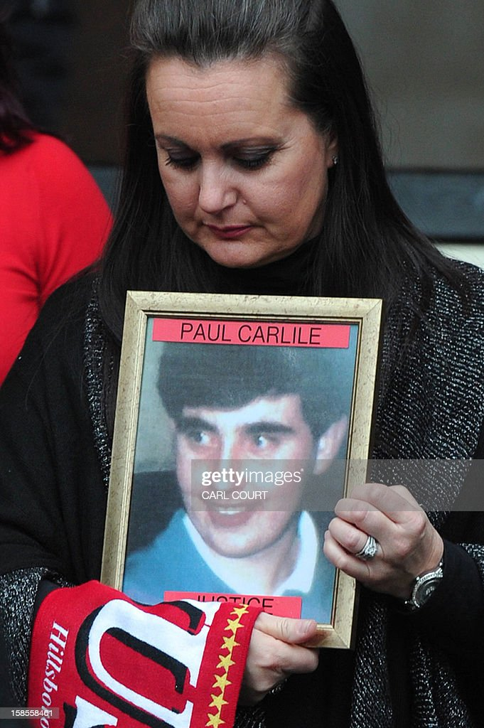 Donna Miller, holds a picture of the brother Paul Carlile she lost in the 1989 Hillsborough disaster, as she leaves with fellow members of the Hillsborough Family Support Group, the High Court in central London on December 19, 2012, after the High Court quashed the original accidental death verdicts returned on 96 Liverpool football fans who died in the tragedy. The request from the Attorney General to quash the original inquest verdicts follows the publication of a damning independent report in September which concluded that 41 of the 96 people who died would have had the 'potential to survive' if they had received medical treatment more quickly. Attorney General Dominic Grieve called for fresh inquests to be held. The fatal crush was caused by huge overcrowding in a terrace at Hillsborough Stadium in the northern English city of Sheffield prior to an FA Cup semi-final between Liverpool and Nottingham Forest in 1989.