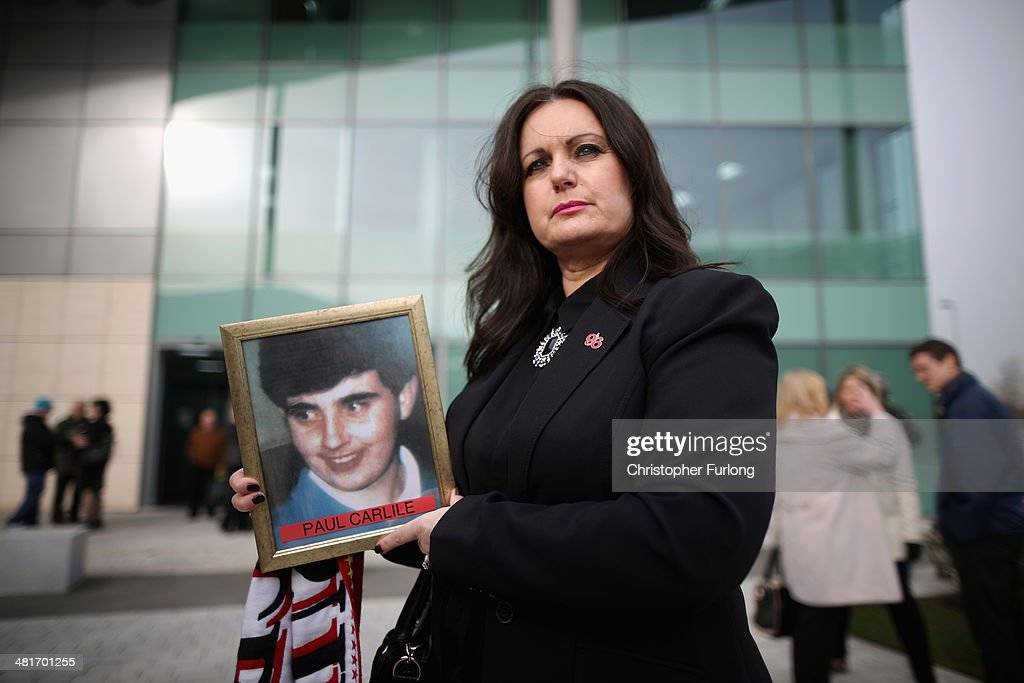 Donna Miller, the sister of victim Paul Carlile, arrives on the opening day for the fresh coroners inquest into the deaths of 96 Liverpool football fans who died in the 1989 Hillsborough tragedy, during which Lord Justice Goldring will be acting as coroner at a specially adapted office building in Birchwood Park on March 31, 2014 in Warrington, England. The new inquest hearing was ordered two years ago when the High Court quashed the original accidental death verdicts that had stood for more than 20 years. The Hillsborough disaster occurred during the FA Cup semi-final tie between Liverpool and Nottingham Forest football clubs in April 1989 at the Hillsborough Stadium in Sheffield, which resulted in the deaths of 96 football fans.