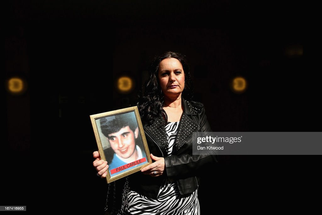 Donna Miller, the sister of victim Paul Carlile, joins other families of the 96 football fans who lost their lives in the Hillsborough disaster at the Family Division of the High Court on April 25, 2013 in London, England. A hearing to decide the date and location of a new inquest into the 96 people who died in the Hillsborough disaster has begun in London. The Hillsborough disaster occurred during the FA Cup semi-final tie between Liverpool and Nottingham Forest football clubs in April 1989 at the Hillsborough Stadium in Sheffield, which resulted in the deaths of 96 football fans.