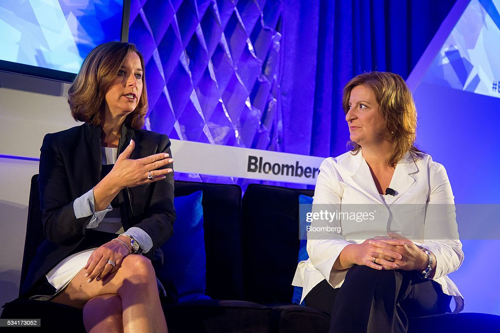 Donna Morris, senior vice president of customer and employee experience at Adobe Systems Inc., left, speaks as Jana Rich, founder and chief executive officer at Rich Talent Group, listens during the Bloomberg Breakaway Summit in New York, U.S., on Wednesday, May 25, 2016. At the inaugural event, participants will hear from corporate leaders investors and government officials on the most crucial issues that impact their ability to find new markets, win over investors, recruit top talent, protect data, and more. Photographer: Michael Nagle/Bloomberg via Getty Images