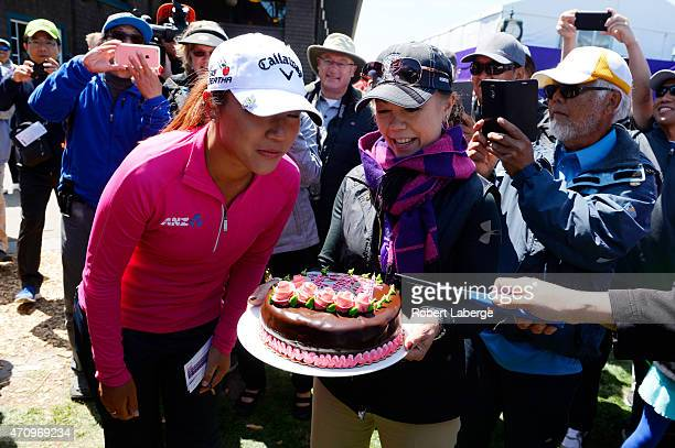 Donna Otis general manager of the Lake Merced Golf Club gives an 18th birthday cake to Lydia Ko of New Zealand during round two of the Swinging...