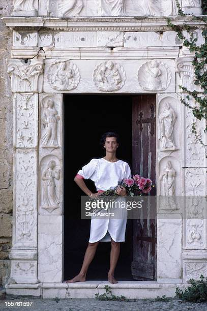 Donna Raimonda Lanza di Trabia holding a bunch of flowers in a doorway at the Castello di Trabia in Sicily October 1984 Photo by Slim Aarons/Getty...