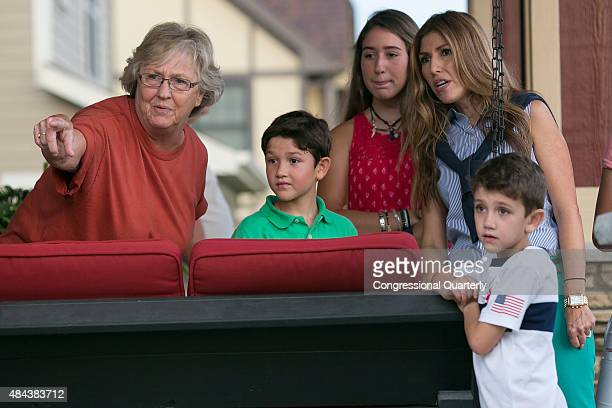 Donna Shelley of Ankeny points out a rabbit to the family of Republican presidential candidate Sen Marco Rubio RFla from left son Dominick daughter...