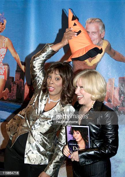 Donna Summer and Bette Midler during Bette Midler's New York Restoration Project's Sixth Annual 'Hulaween' at Marriott Marquis Hotel in New York City...