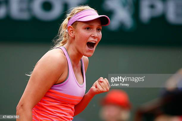 Donna Vekic of Croatia celebrates a point in her Women's Singles match against Caroline Garcia of France on day one of the 2015 French Open at Roland...