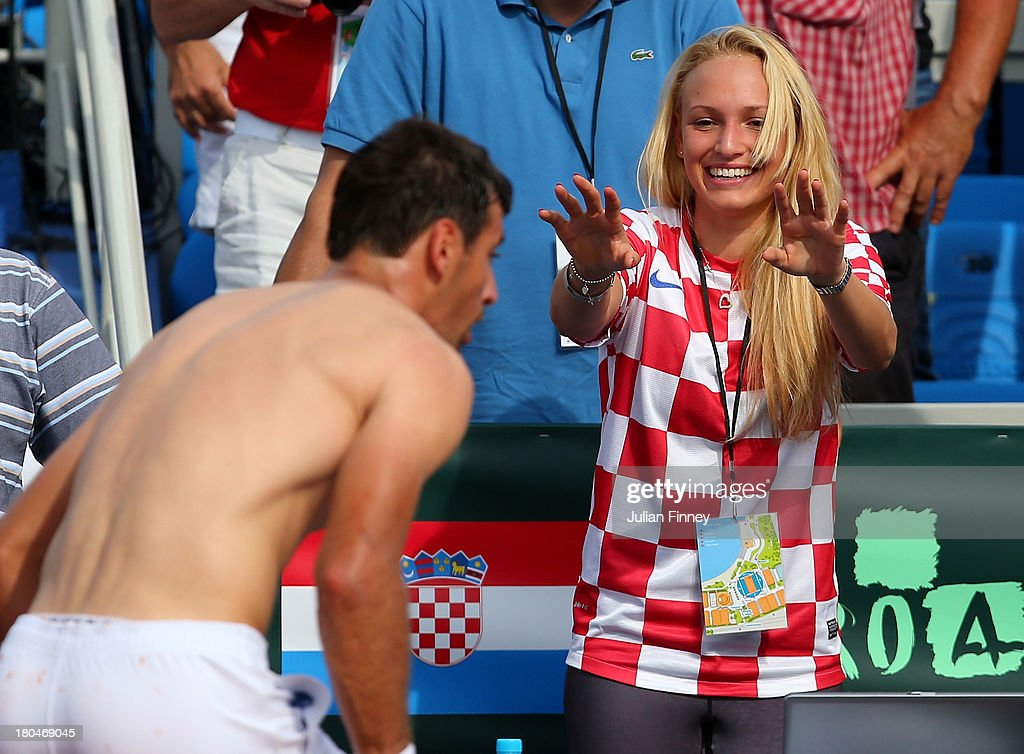 Donna Vekic of Croatia enjoys Ivan Dodig's win over Daniel Evans during day one of the Davis Cup World Group playoff tie between Croatia and Great...