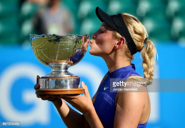 Donna Vekic of Croatia lifts the trophy after victory in her Women's Singles Final match against Johanna Konta of Great Britain during day 7 of the...
