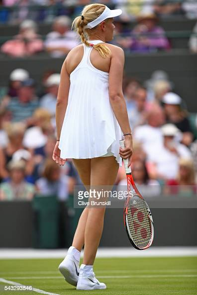 Donna Vekic of Croatia looks on during the Ladies Singles first round against Venus Williams of The United States on day one of the Wimbledon Lawn...