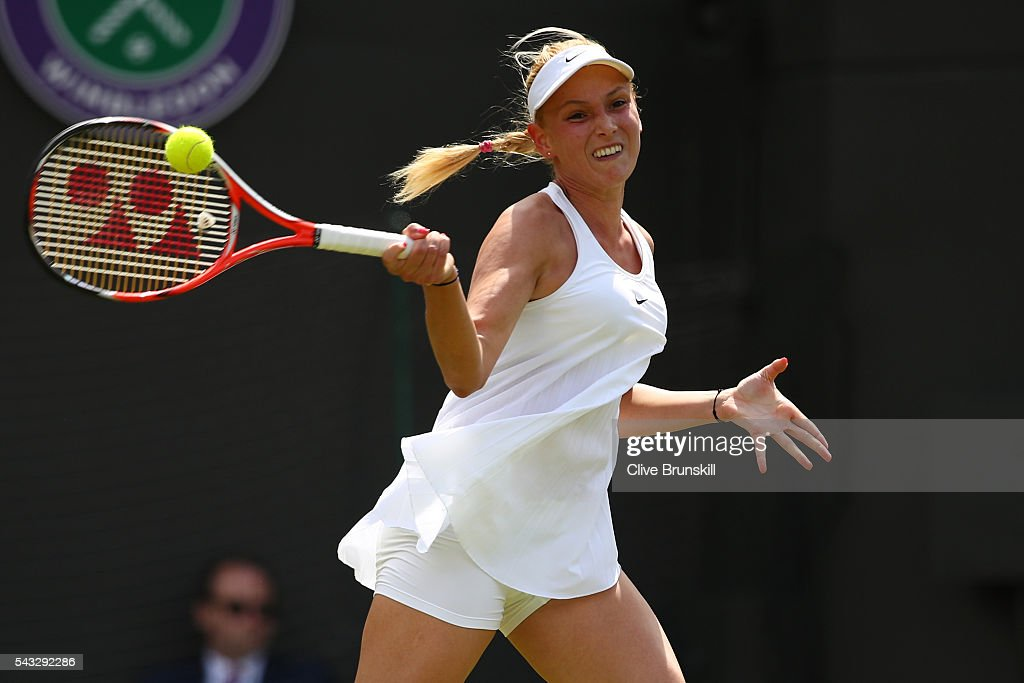Donna Vekic of Croatia plays a forehand shot during the Ladies Singles first round against Venus Williams of The United States on day one of the Wimbledon Lawn Tennis Championships at the All England Lawn Tennis and Croquet Club on June 27th, 2016 in London, England.