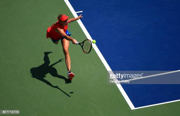 Donna Vekic of Croatia plays a shot against Eugenie Bouchard of Canada during Day 4 of the Rogers Cup at Aviva Centre on August 8 2017 in Toronto...