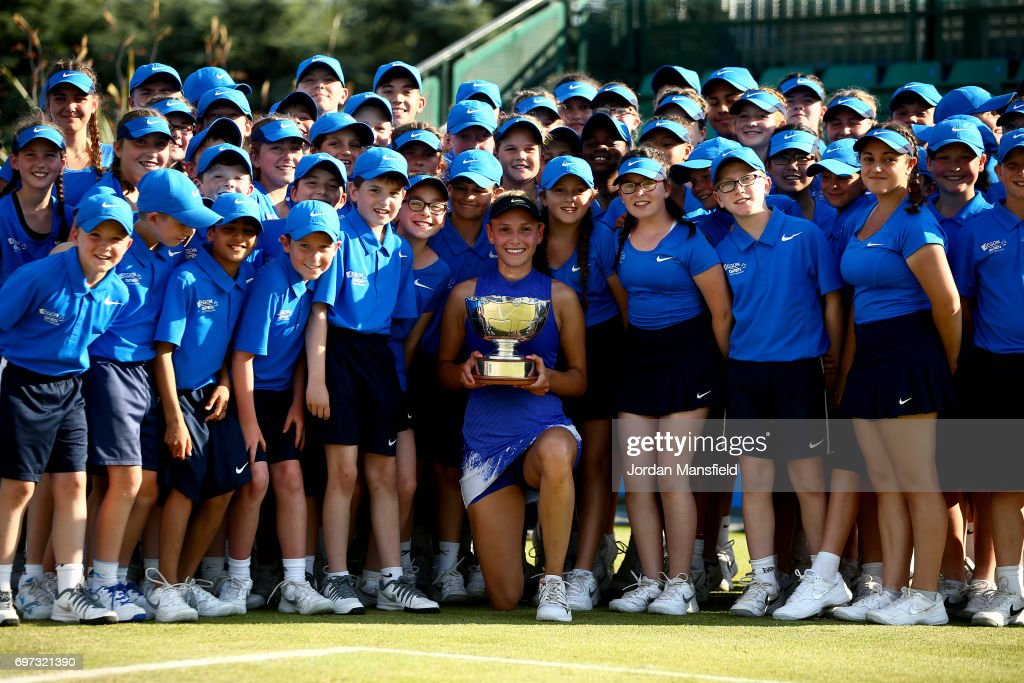 Donna Vekic of Croatia poses with the trophy and the ballkids after victory in her Women's Singles Final match against Johanna Konta of Great Britain during day 7 of the Aegon Open Nottingham at the Nottingham Tennis Centre on June 18, 2017 in Nottingham, England.