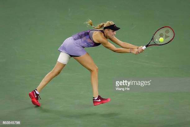 Donna Vekic of Croatia returns a shot during the match against Shuai Zhang of China on Day 2 of 2017 Dongfeng Motor Wuhan Open at Optics Valley...