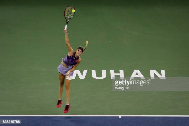 Donna Vekic of Croatia serves against Shuai Zhang of China on Day 2 of 2017 Dongfeng Motor Wuhan Open at Optics Valley International Tennis Center on...