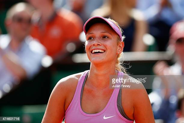 Donna Vekic of Croatia smiles during her Women's Singles match against Caroline Garcia of France on day one of the 2015 French Open at Roland Garros...