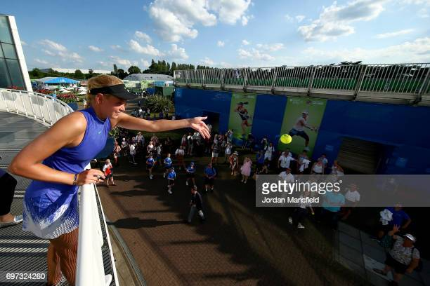 Donna Vekic of Croatia throws balls to fans after victory in her Women's Singles Final match against Johanna Konta of Great Britain during day 7 of...