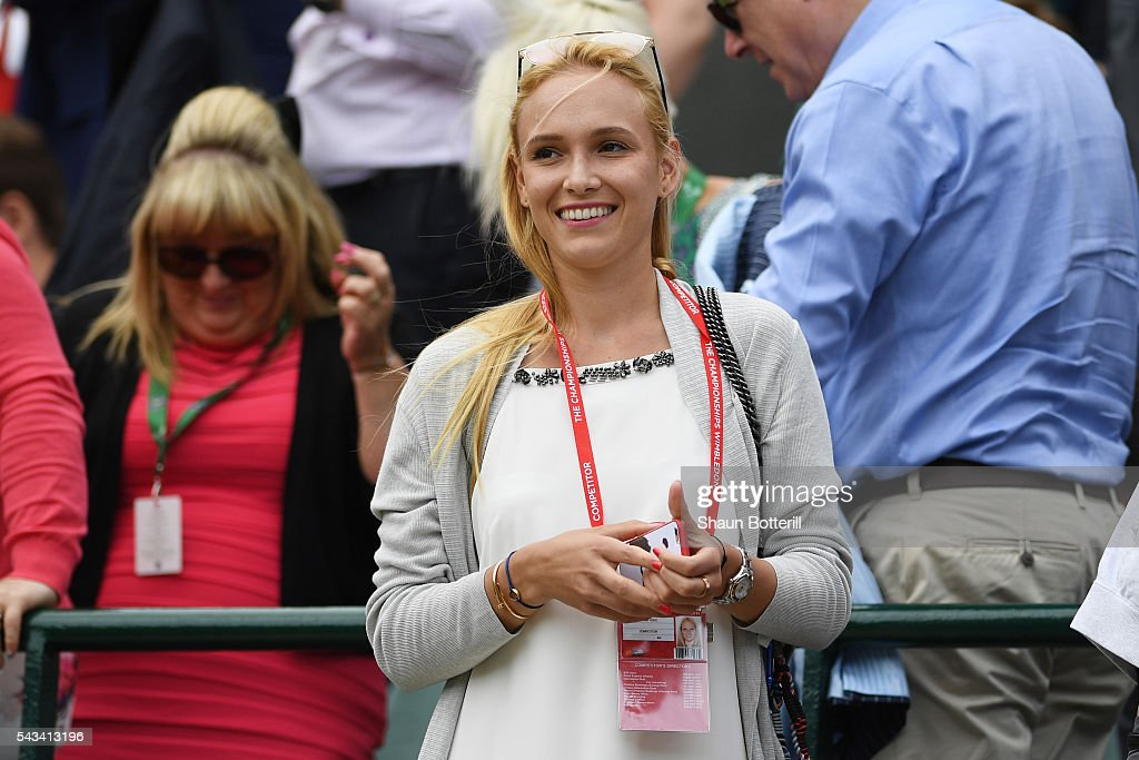 Donna Vekic, partner to Stan Wawrinka of Switzerland watches on has he beats Taylor Fritz of The United States in the Men's Singles first round match on day two of the Wimbledon Lawn Tennis Championships at the All England Lawn Tennis and Croquet Club on June 28, 2016 in London, England.