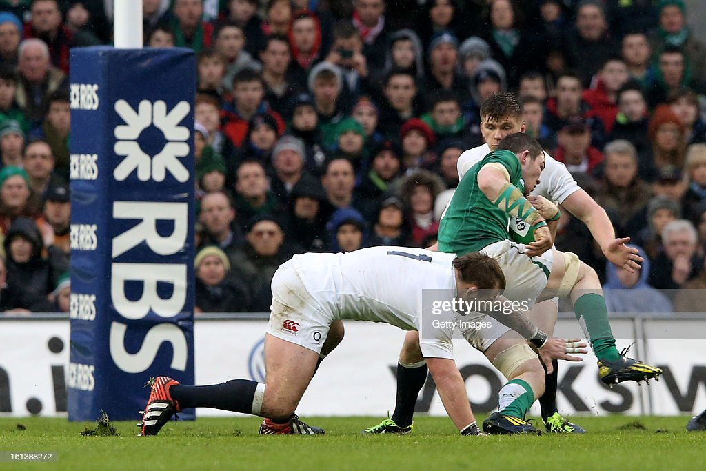 Donnacha Ryan of Ireland is challenged by Joe Marler and Owen Farrell of England during the RBS Six Nations match between Ireland and England at Aviva Stadium on February 10, 2013 in Dublin, Ireland.
