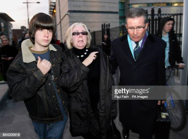 DonnaMaria Barker who lost her son James in the Omagh bomb explosion leaves Belfast High Court with her son Oliver and husband Victor after Sean Hoey...