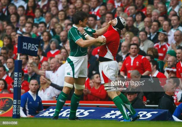 Donncha O'Callaghan of Ireland gets to grips with Ryan Jones of Wales during the RBS 6 Nations Championship match between Wales and Ireland at the...