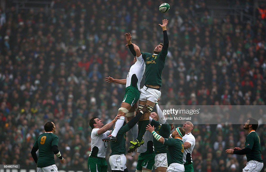 Donncha O�Callaghan of Ireland jumps with Andries Bekker of South Africa in the lineout during the Guinness Series 2009 match between Ireland and...