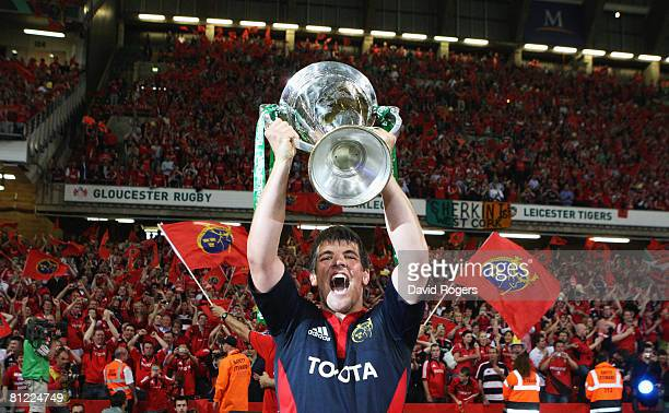 Donncha O'Callaghan of Munster celebrates with the trophy following his team's victory in the Heineken Cup Final between Munster and Toulouse at the...