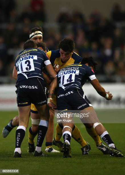 Donncha O'Callaghan of Worcester Warriors crashes into Sam James and Denny Solomona of Sale Sharks during the Aviva Premiership match between Sale...