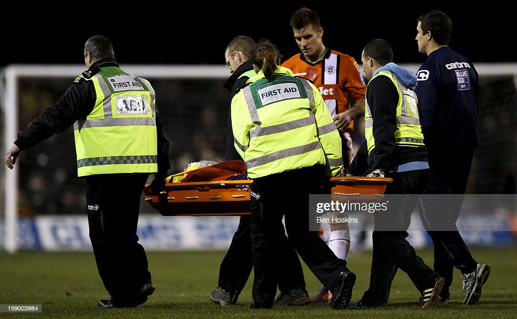 Donnell of Luton is carried off on a stretcher after picking up and injury during the FA Cup with Budweiser Third Round match between Luton Town and Wolverhampton Wanderers at Kenilworth Road on January 5, 2013 in Luton, England.