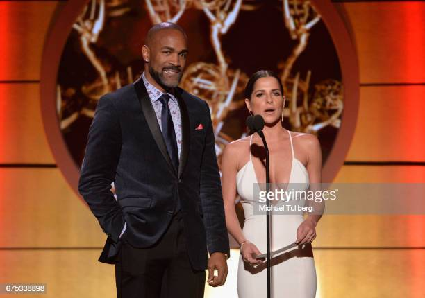 Donnell Turner left and Kelly Monaco present the award for younger actress in a drama series at the 44th annual Daytime Emmy Awards at Pasadena Civic...
