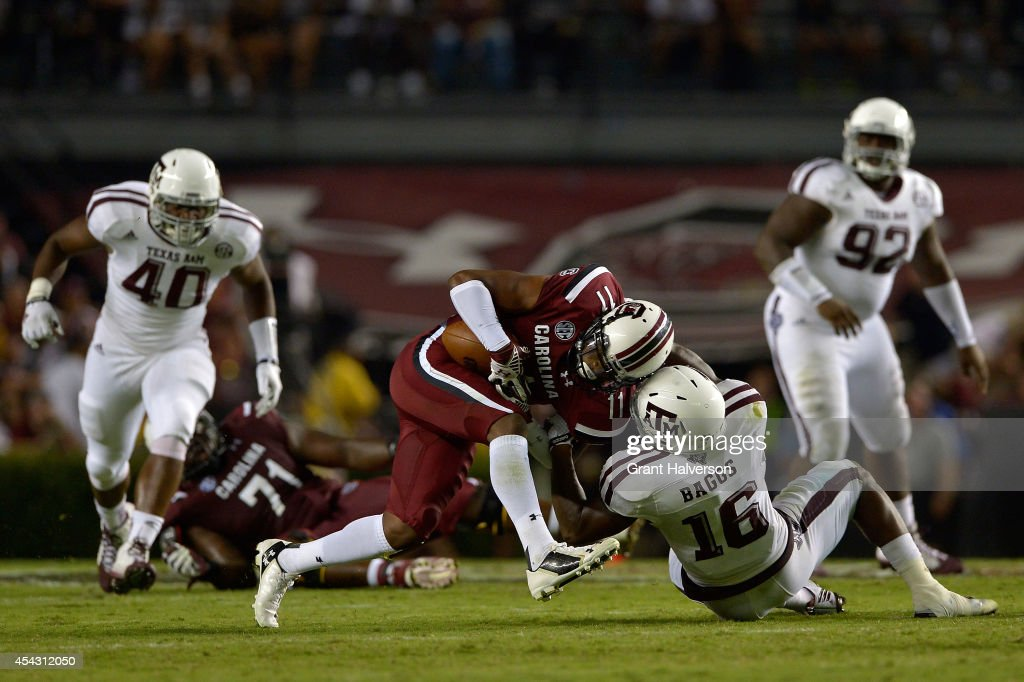 Donnie Baggs #16 of the Texas A&M Aggies tackles <a gi-track='captionPersonalityLinkClicked' href=/galleries/search?phrase=Pharoh+Cooper&family=editorial&specificpeople=11371015 ng-click='$event.stopPropagation()'>Pharoh Cooper</a> #11 of the South Carolina Gamecocks during their game at Williams-Brice Stadium on August 28, 2014 in Columbia, South Carolina. Texas A&M won 52-28.