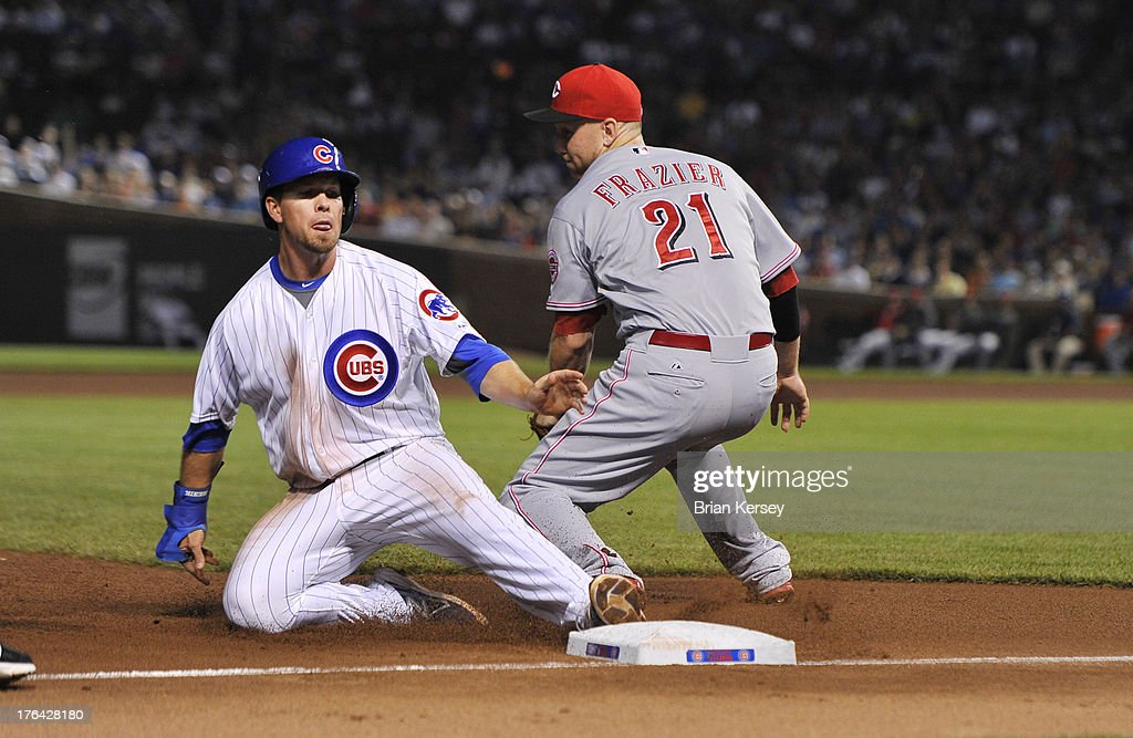 Donnie Murphy #8 of the Chicago Cubs (L) slides safely into third base, advancing from first on a single hit by teammate Darwin Barney #15, as third baseman <a gi-track='captionPersonalityLinkClicked' href=/galleries/search?phrase=Todd+Frazier&family=editorial&specificpeople=4778756 ng-click='$event.stopPropagation()'>Todd Frazier</a> #21 of the Cincinnati Reds gets the throw from the outfield during the fifth inning at Wrigley Field on August 12, 2013 in Chicago, Illinois.