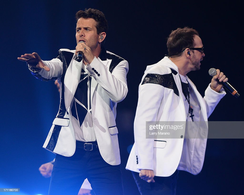 Donnie Wahlberg and Joey McIntyre of New Kids On The Block perform during The Package Tour at BB&T Center on June 22, 2013 in Sunrise, Florida.