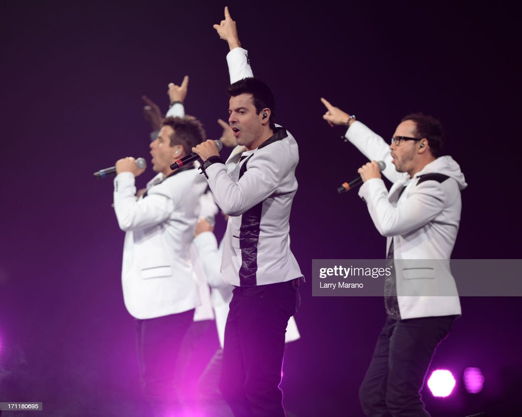 Donnie Wahlberg, Joey McIntyre, Jordan Knight, Jonathan Knight and Danny Wood of New Kids On The Block perform during The Package Tour at BB&T Center on June 22, 2013 in Sunrise, Florida.
