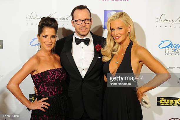 Donnie Wahlberg Kelly Monaco and Jenny McCarthy attend the Dancing with the Stars Charity event hosted by Jenny McCarthy on August 24 2013 at Hotel...