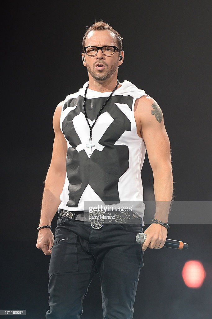 <a gi-track='captionPersonalityLinkClicked' href=/galleries/search?phrase=Donnie+Wahlberg&family=editorial&specificpeople=220537 ng-click='$event.stopPropagation()'>Donnie Wahlberg</a> of New Kids On The Block performs during The Package Tour at BB&T Center on June 22, 2013 in Sunrise, Florida.