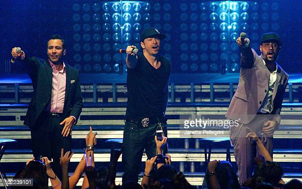 Donnie Wahlberg of New Kids On The Block performs on stage with special guest Howie Dorough and AJ McLean of Backstreet Boys at Radio City Music Hall...