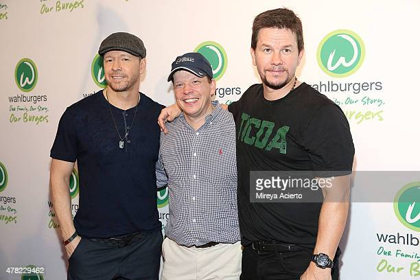 Donnie Wahlberg Paul Wahlberg and Mark Wahlberg attend the Wahlburgers Coney Island VIP Preview Party at Wahlburgers Coney Island on June 23 2015 in...