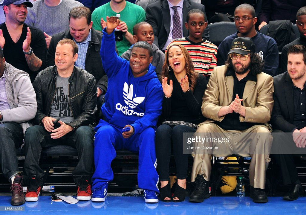 Donnie Wahlberg Tracy Morgan Megan Wollover and Judah Friedlander attend the Philadelphia 76ers vs the New York Knicks game at Madison Square Garden...