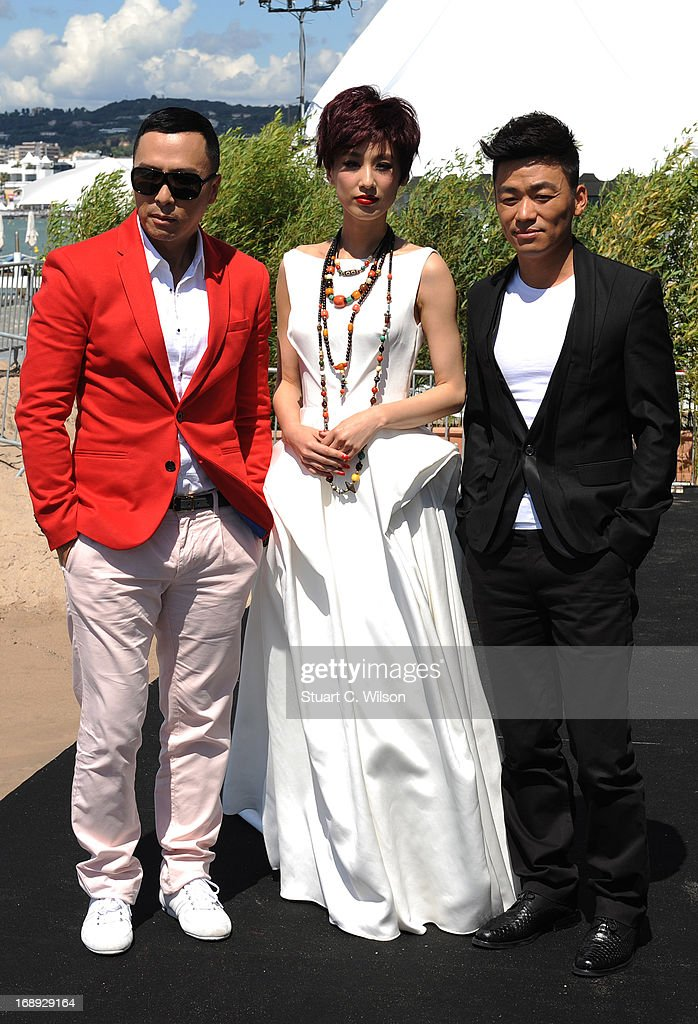 Donnie Yen Eva Huang and Wang Boaqiang attend the 'Iceman Cometh 3D' Photocall and Press conference at the 66th Annual Cannes Film Festival on May 17...