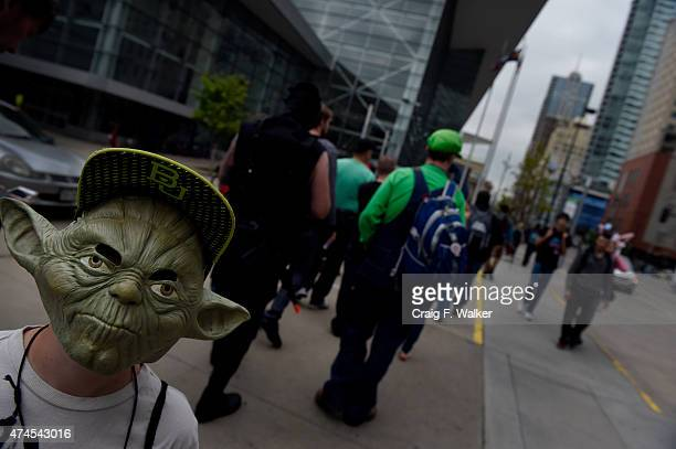 Donning a Yoda mask Nick Born arrives at Denver Comic Con at the Colorado Convention Center in Denver CO May 23 2015 In only its fourth year the...