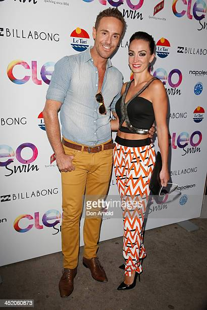 Donny Galella and Livia Tassanyi pose at the 2013 CLEO Swim Party at The Bucket List on November 26 2013 in Sydney Australia