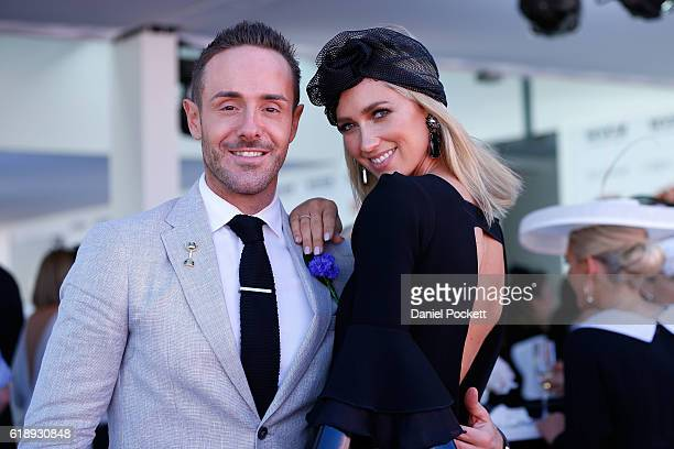 Donny Galella and Nikki Phillips pose at the Fashions On The Field Marquee on Victoria Derby Day at Flemington Racecourse on October 29 2016 in...