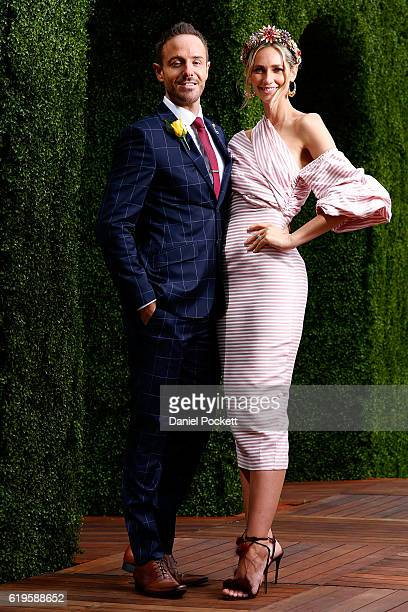 Donny Galella and Nikki Phillips pose on Emirates Melbourne Cup Day at Flemington Racecourse on November 1 2016 in Melbourne Australia